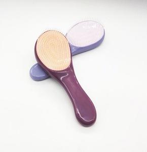 magic-anti-static-hair-comb-fashion-tt-plastic-hair-brushes-detangling-handle-tangle-shower-hair-comb-styling-tamer-tool5-0025174001556874732